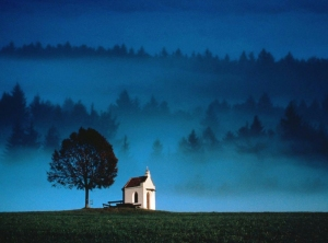 Tiny-Church-Overlooking-Misty-Valley,-Germany